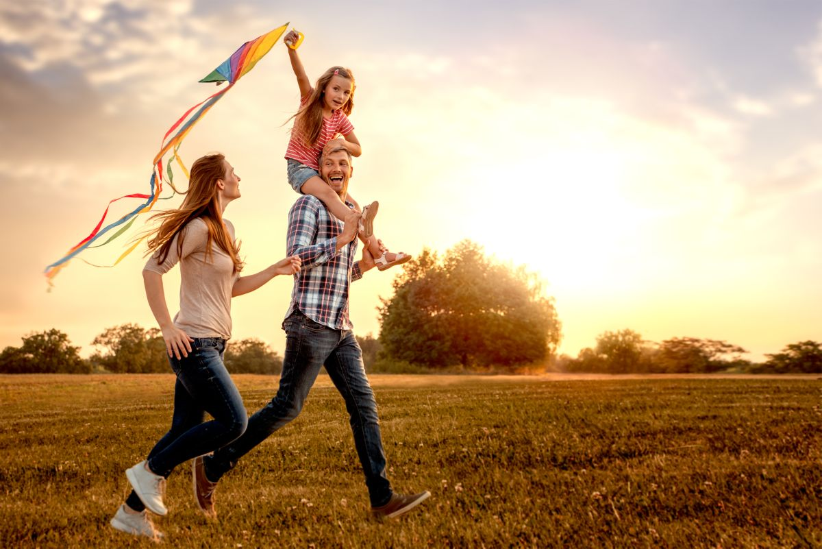 Family,Running,Through,Field,Letting,Kite,Fly