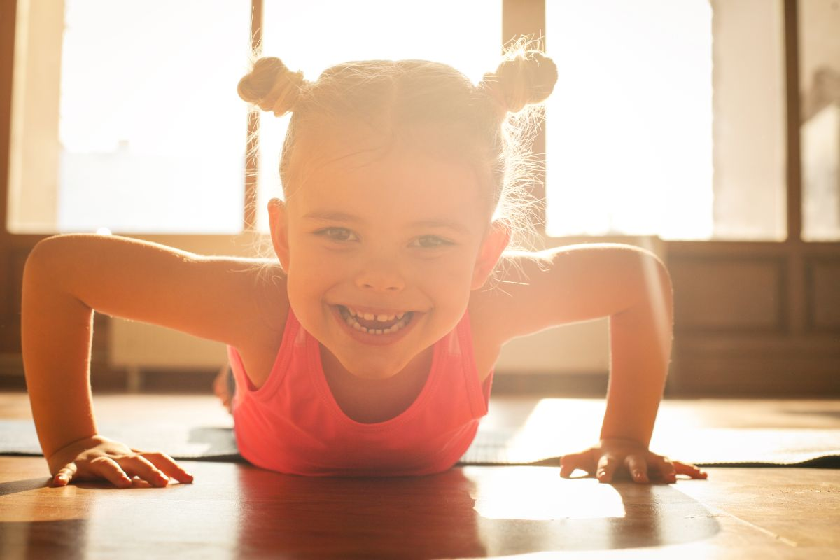 Little,Girl,Workout,At,Home.,Looking,At,Camera.