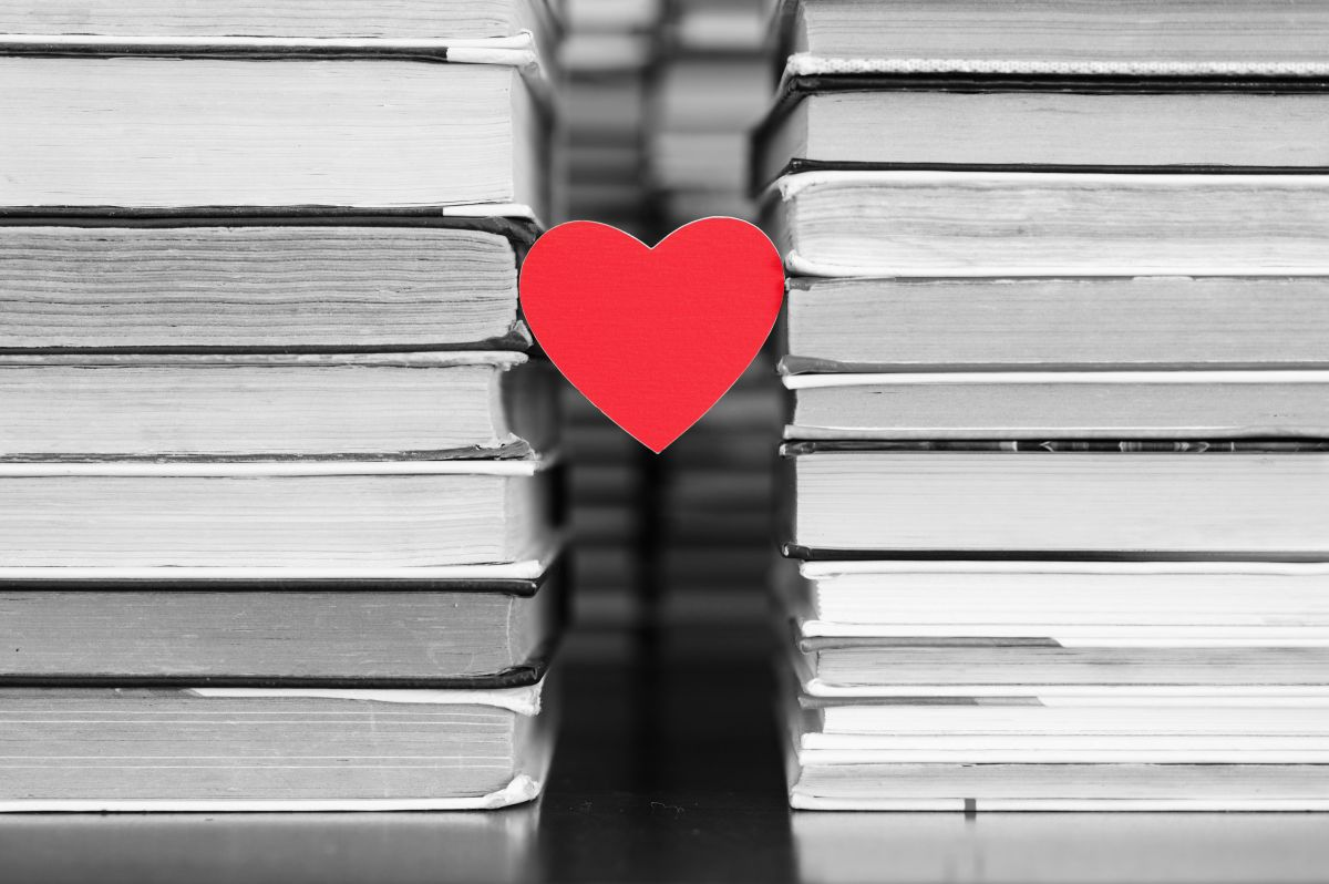 A,Red,Heart,Hangs,Between,The,Stacks,Of,Books,In