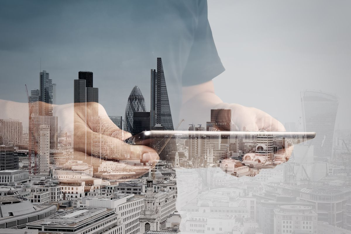 Double,Exposure,Of,Success,Businessman,Using,Digital,Tablet,With,London