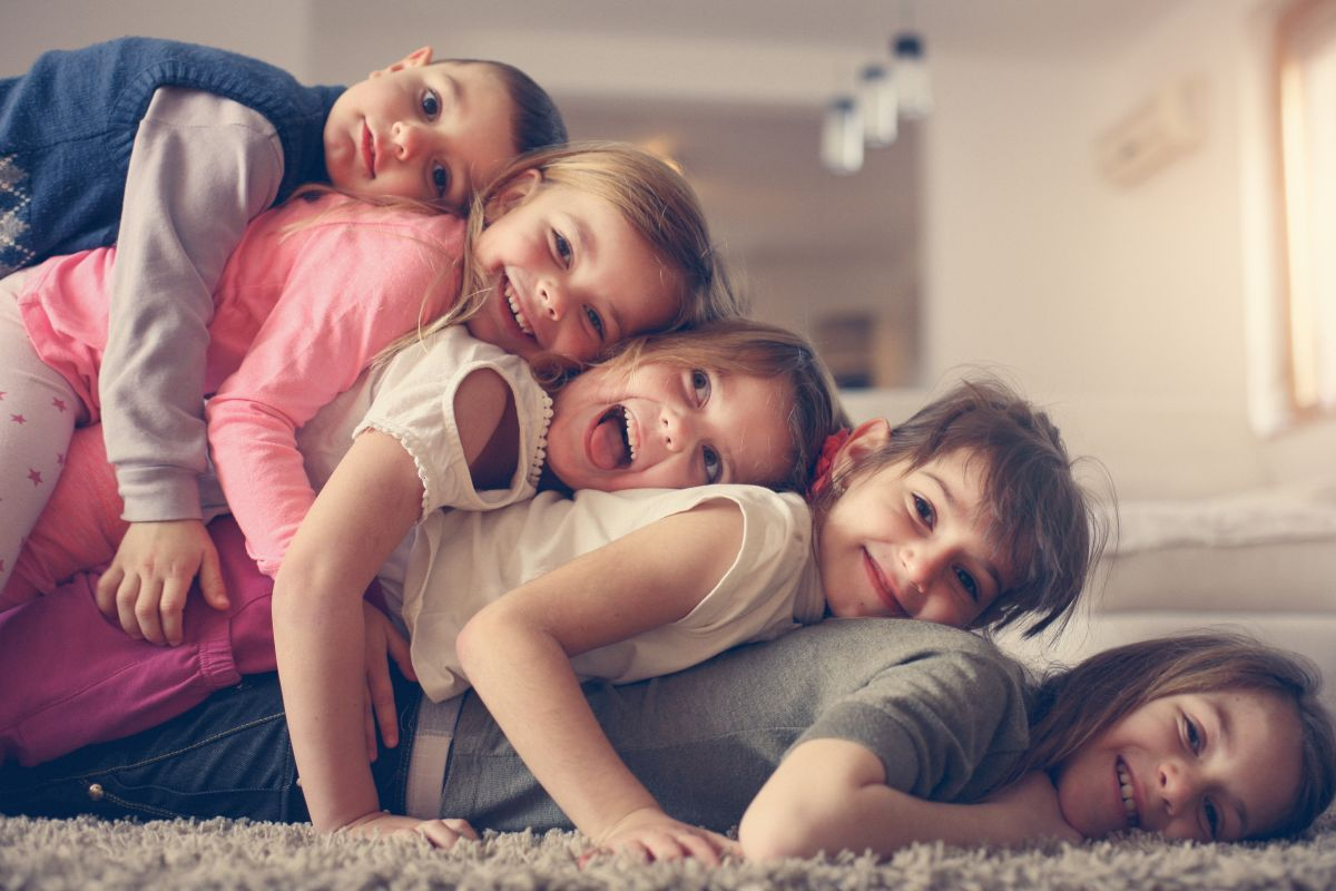Large,Group,Of,Children,Lying,At,Floor,And,Having,Fun.