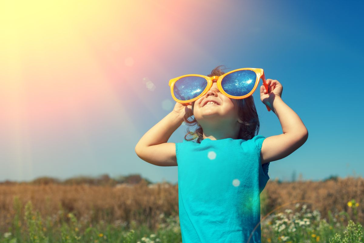 Happy,Little,Girl,With,Big,Sunglasses,Walking,In,The,Meadow